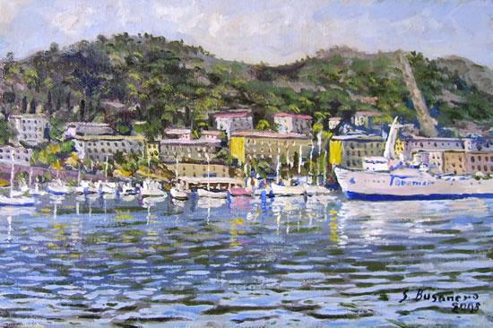 Marina invernale: barche a vela nel porto e traghetto della Toremar