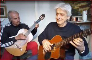 Findi e Giocatore si dilettano con le loro chitarre